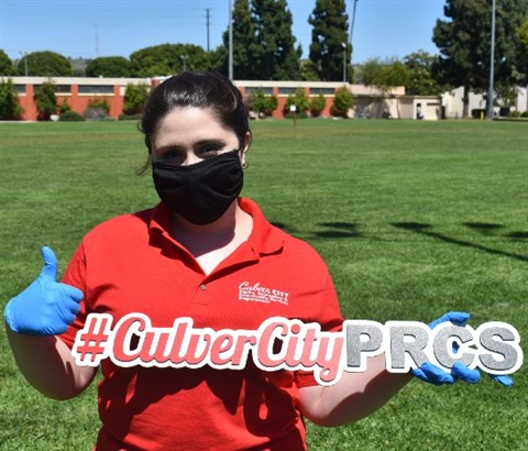 Staff Holding Sign #CulverCityPRCS with Gloves and Thumbs Up.