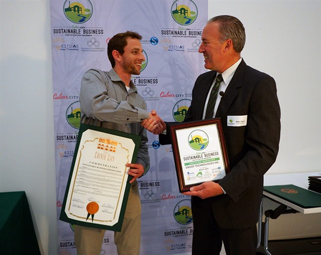 Council Member Alex Fisch presenting Sustainable Certificate to Envoy