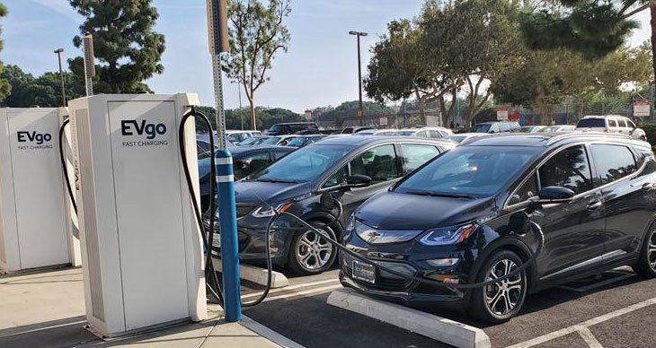 Photograph of cars plugged intoEVgo electric vehicle charging stations
